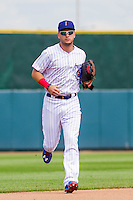 Iowa Cubs outfielder Albert Almora Jr. (6) heads to the dugout during a game against the Colorado Springs Sky Sox on September 4, 2016 at Principal Park in Des Moines, Iowa. Iowa defeated Colorado Springs 5-1. (Brad Krause/Four Seam Images)