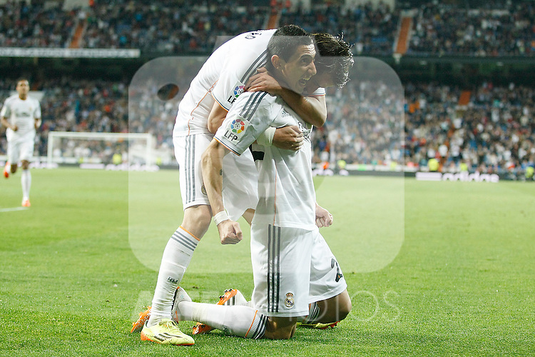 Real Madrid´s Di Maria celebrates with Coentrao after scoring a goal during La Liga match in Santiago Bernabeu stadium in Madrid, Spain. April 13, 2014. (ALTERPHOTOS/Victor Blanco)