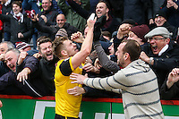 James Collins of Northampton Town celebrates the winning goal with the Northampton Town supporters during the Sky Bet League 2 match between Stevenage and Northampton Town at the Lamex Stadium, Stevenage, England on 19 March 2016. Photo by David Horn / PRiME Media Images.