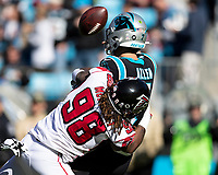 CHARLOTTE, NC - NOVEMBER 17: Kyle Allen #7 of the Carolina Panthers is tackled immediately after releasing the pass by Takkarist McKinley #98 of the Atlanta Falcons during a game between Atlanta Falcons and Carolina Panthers at Bank of America Stadium on November 17, 2019 in Charlotte, North Carolina.
