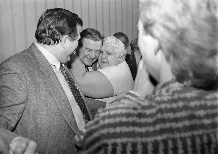 "Rep. Daniel David ""Dan"" Rostenkowski, D-Ill., Chairman of the Ways and Means Committee, gets a bear hug on his way up to call Bingo. Febuary 19, 1994 (Photo by Chris Martin/CQ Roll Call)"