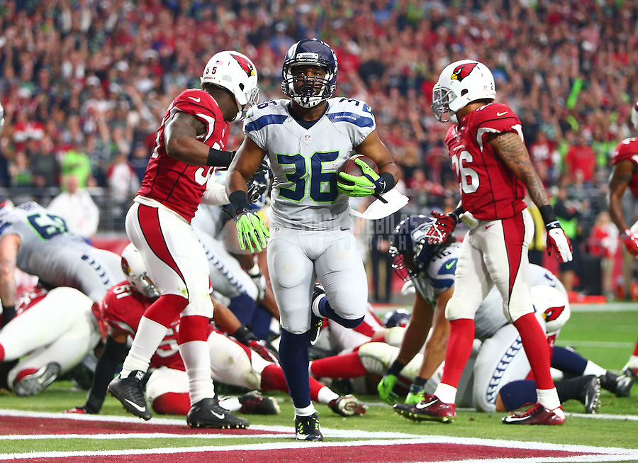 Jan 3, 2016; Glendale, AZ, USA; Seattle Seahawks running back Bryce Brown (36) scores a first quarter touchdown against the Arizona Cardinals at University of Phoenix Stadium. Mandatory Credit: Mark J. Rebilas-USA TODAY Sports