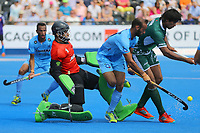 Pakistan players Ajmad Ali and Muhammad Aleem Bilal stop India's Ramandeep Singh during the Hockey World League Semi-Final match between Pakistan and India at the Olympic Park, London, England on 18 June 2017. Photo by Steve McCarthy.
