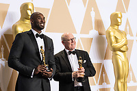 Kobe Bryant and Glen Keane pose backstage with the Oscar&reg; for best animated short film for work on &ldquo;Dear Basketball&rdquo; during the live ABC Telecast of The 90th Oscars&reg; at the Dolby&reg; Theatre in Hollywood, CA on Sunday, March 4, 2018.<br /> *Editorial Use Only*<br /> CAP/PLF/AMPAS<br /> Supplied by Capital Pictures