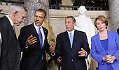 United States President Barack Obama, flanked by U.S. Senate Majority Leader Harry Reid(Democrat of Nevada), left, Speaker of the U.S. House John Boehner (Democrat of Nevada) and U.S. Senate Democratic Leader Nancy Pelosi (Democrat of California), right, unveil the statue of Rosa Parks in Statuary Hall of the United States Capitol February 27, 2013 in Washington, DC. .Credit: Olivier Douliery / Pool via CNP