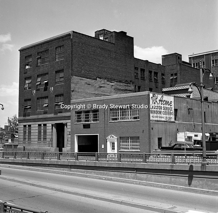 Pittsburgh PA:  View of businesses along Fort Pitt Boulevard.  Acme Janitor Service and Hyle and Patterson were two of the businesses on Fort Pitt Boulevard in 1966. This would be the future home of the Westinghouse Building which was completed in 1969.
