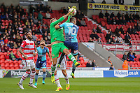 Matthew Bloomfield of Wycombe Wanderers  (right) challenges goalkeeper Ross Etheridge of Doncaster Rovers before opening the scoring during the Sky Bet League 2 match between Doncaster Rovers and Wycombe Wanderers at the Keepmoat Stadium, Doncaster, England on 29 October 2016. Photo by David Horn.