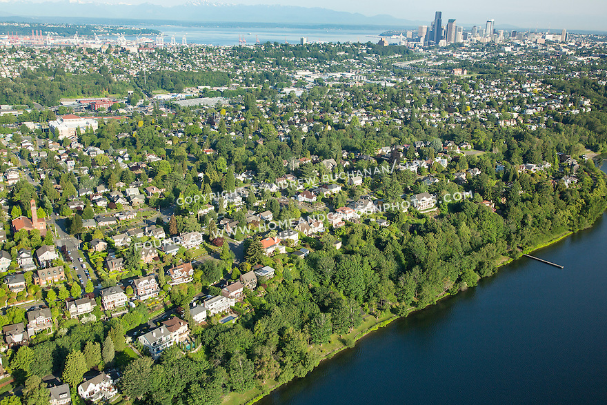 aerial photograph of Seattle's Mount Baker waterfront residential neighborhood on the shore of Lake Washington, with Port of Seattle and downtown Seattle skyline beyond