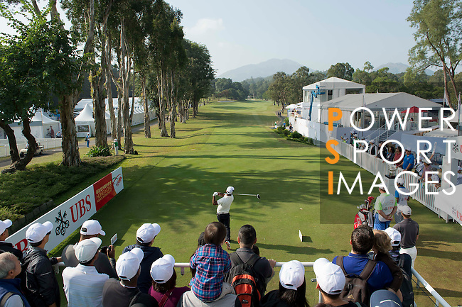 Siddikur Rahman of Bangladesh tees off the first hole while the crowd of spectator watches during the 58th UBS Hong Kong Golf Open as part of the European Tour on 11 December 2016, at the Hong Kong Golf Club, Fanling, Hong Kong, China. Photo by Marcio Rodrigo Machado / Power Sport Images