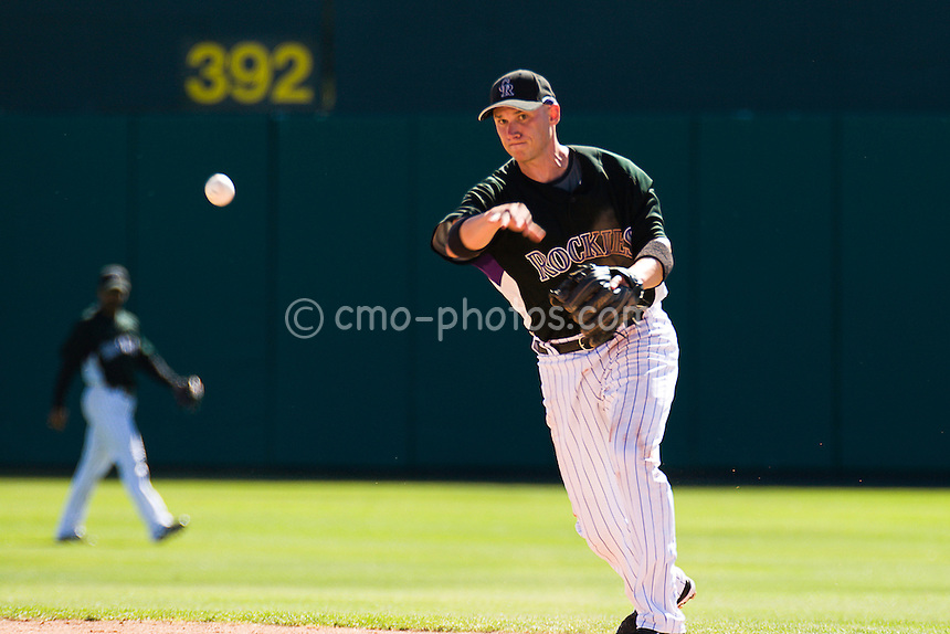 Mar 21, 2008; Tucson, AZ, USA;  Colorado Rockies second baseman Clint Barmes (12) throws to first during a game against the Chicago Cubs at Hi Corbett Field.