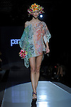 A model on the catwalk during the presentation of the Parah Beach wear Women's Spring Summer 2014 collection at Milan Fashion Week.