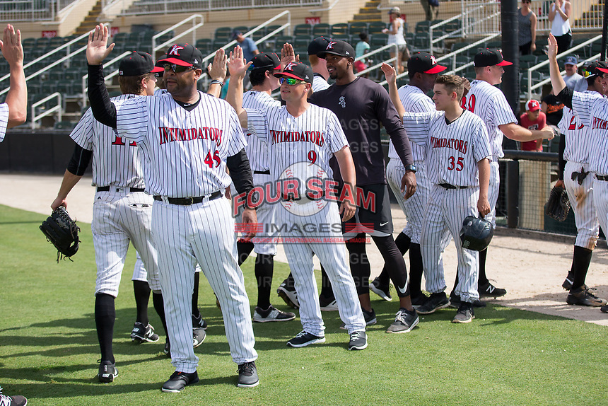 Kannapolis Intimidators manager Justin Jirschele (9) high fives his team as they celebrate their win over the West Virginia Power at Kannapolis Intimidators Stadium on June 18, 2017 in Kannapolis, North Carolina.  The Intimidators defeated the Power 5-3 to win the South Atlantic League Northern Division first half title.  It is the first trip to the playoffs for the Intimidators since 2009.  (Brian Westerholt/Four Seam Images)