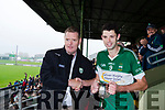 A delighted Listry captain Jimmy O'Leary receives the Castleisland Mart Junior championship Cup from Kerry County Comm chairman Tim Murphy