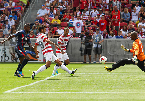 13.07.2013. Sandy, Utah, USA. US Men's National forward Chris Wondolowski (19) kicks the ball past Cuba goal keeper Odelin Molina (1) during the CONCACAF Gold Cup soccer match between USA Men's National team and Cuba at Rio Tinto Stadium in Sandy, UT. USA.