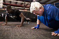 NWA Democrat-Gazette/CHARLIE KAIJO Grant Wetherill does pushups during a boxing class geared towards people with Parkinson's disease, Monday, December 10, 2018 at Straightright Boxing and Fitness Springdale.