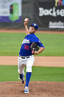 James Baune (35) of the Ogden Raptors delivers a pitch to the plate against the Orem Owlz in Pioneer League action at Lindquist Field on June 27, 2014 in Ogden, Utah.  (Stephen Smith/Four Seam Images)