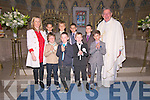 Scoil Naomh Iognaid Rís pupils Daithí Budhlaeir, Lucas Ó Conchúir, Conchúr Ó Criomín, Jack Ó Currain, Padraig Mac Eochaidh, Fergal Mc Gabhann, Samuel Mac Gibiún Ó Maille and Aivaras Uosis with their principal Róisín Uí Bheaglaoí and Canon Tomas Ó Luanaigh,  the day of their First Communion at St. Mary's Church, Dingle, on Sunday afternoon..