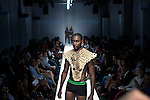JOHANNESBURG, SOUTH AFRICA - MARCH 27: A model shows clothes from the Loxion Kulca by Ole Ledimo brand on the catwalk at the South African fashion week on March 27, 2010, Turbine Hall in central Johannesburg, South Africa. Buyers and celebrities watched the three day fashion week. (Photo by Per-Anders Pettersson)
