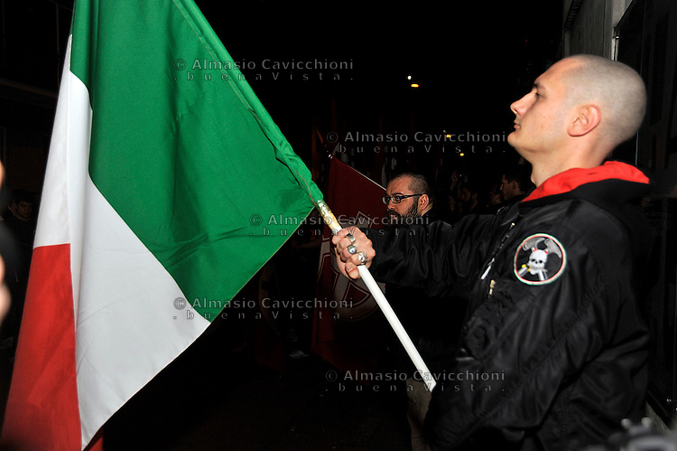 29 Apr 2012; Milano: corteo dei movimenti della destra radicale, con corone floreali e croci celtiche, in piazzale Susa per ricordare Sergio Ramelli, Enrico Pedenovi e Carlo Borsani..April 29, 2012, Milan: parade of groups of the radical right, with fluneral wreaths and Celtic crosses, in Piazzale Susa to remember the death of the right wing militants Sergio Ramelli, Enrico Pedenovi  and Carlo Borsani.