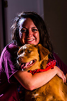 A young woman with her dog, an Australian Shepherd/Golden retriever mix, Littleton, Colorado USA.