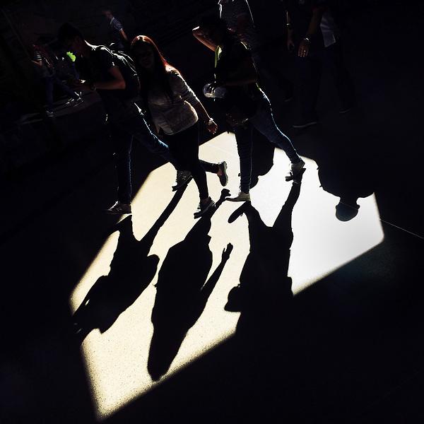 Passengers walk through a beam of light thrown on the platform of San Antonio metro station in Medellín, Colombia, 13 December 2016.