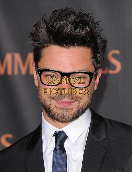 Dominic Cooper.The World Premiere of 'Immortals' held at The Nokia Theater Live in Los Angeles, California, USA..November 7th, 2011.headshot portrait black white tie glasses beard facial hair.CAP/RKE/DVS.©DVS/RockinExposures/Capital Pictures.