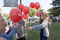 NWA Democrat-Gazette/FLIP PUTTHOFF<br />CENTERTON DAY CELEBRATION<br />Amanda Edwards (right) hands out balloons Saturday Sept. 9 2017 at the annual Centerton Day celebration at Centerton city park and other venues around the city. The event included a parade, car show, tiny tot contest, fish fry and more. Edwards handed our balloons for Lifepoint Baptist Church in Centerton.