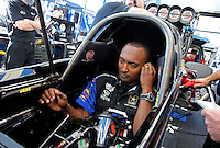 Feb. 14, 2013; Pomona, CA, USA; NHRA top fuel dragster driver Antron Brown during qualifying for the Winternationals at Auto Club Raceway at Pomona.. Mandatory Credit: Mark J. Rebilas-