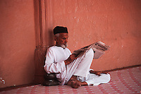 Portrait Rajpute man reading newspaper wearing a beard and a turban, Rajasthan, India, Asia