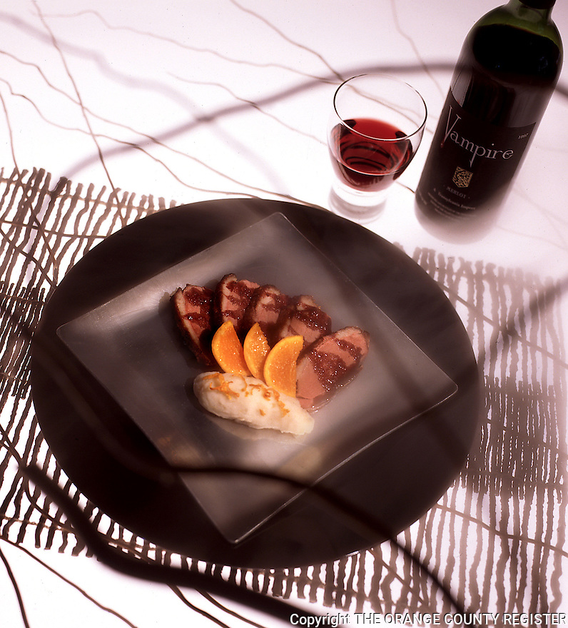 Duck with Merlot licorice sauce, Potato and Celery root puree with honeyed tangerines. Portfolio only.