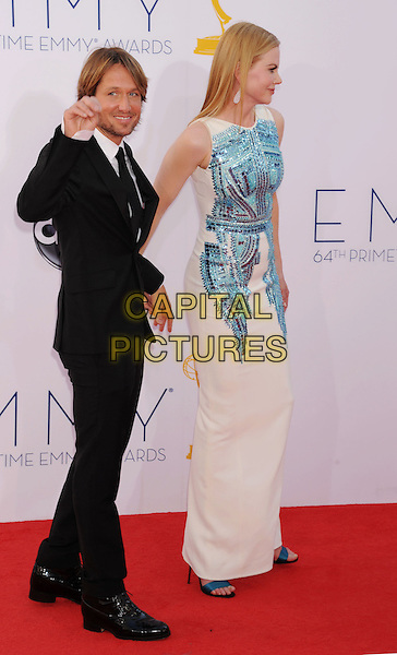 Keith Urban, Nicole Kidman.The 64th Anual Primetime Emmy Awards held at Nokia Theatre L.A. Live in Los Angeles, California, USA..September 23rd, 2012.emmys full length black suit white shirt tie beard stubble facial hair blue sleeveless sequins sequined dress married husband wife side tall short hand arm waving .CAP/ROT/TM.© TM/Roth/Capital Pictures