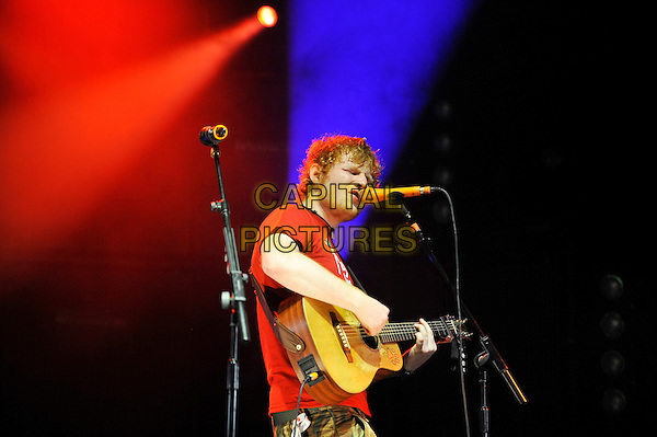 Ed Sheeran .performing at V Festival, Hylands Park, Chelmsford, Essex, England. .18th August 2012.on stage in concert live gig performance music half length red t-shirt tattoo singing guitar side.CAP/MAR.© Martin Harris/Capital Pictures.