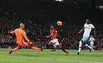 Darren Randolph of West Ham United saves as Marcus Rashford of Manchester United is clear through during the Premier League match at the Old Trafford Stadium, Manchester. Picture date: November 27th, 2016. Pic Simon Bellis/Sportimage