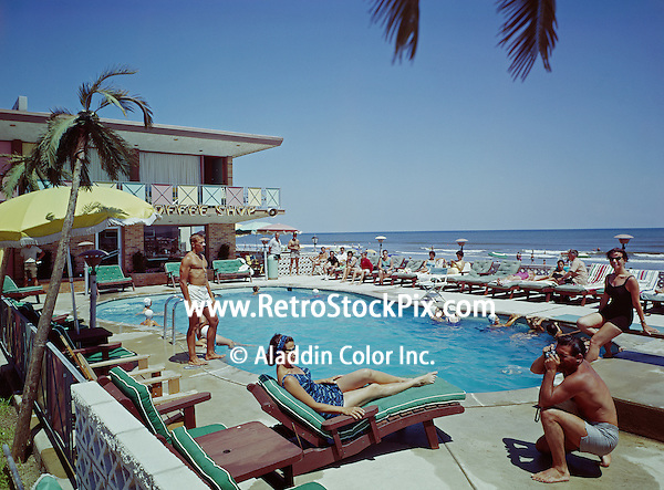 Crown Motel, Wildwood, NJ. Man taking a picture of a woman lounging by the pool.