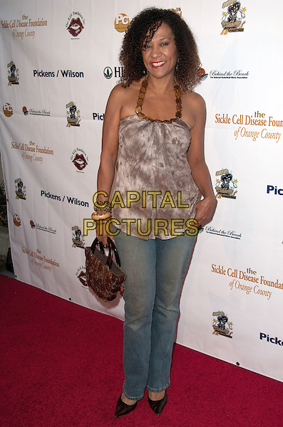 KIKI SHEPARD .K.I.S. Foundation celebrates the 100th discovery year of Sickle Cell Disease with their Annual Bowling Challenge held at PINZ Entertainment  Center, Studio City, CA, USA..September 17th, 2010.full length jeans denim brown print top.CAP/ADM/DT.©Daniel Tanner/AdMedia/Capital Pictures.