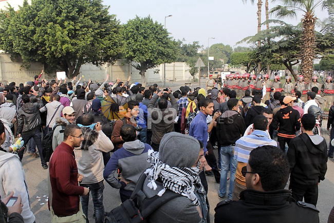 Students of Ain Shams University, who are supporters of the Muslim Brotherhood and ousted Egyptian President Mohamed Mursi, take part in a protest against the military and Interior Ministry near the Ministry of Defense building in Cairo December 18, 2013. Egyptians will vote on a new constitution on Jan. 14 and 15, pushing on with the army-backed government's plan for transition back to democracy after its overthrow of elected Islamist President Mursi. Photo by Mohammed Bendari