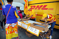 DHL placards are distributed to fans on day two of the 2016 HSBC Wellington Sevens at Westpac Stadium, Wellington, New Zealand on Saturday, 30 January 2016. Photo: Dave Lintott / lintottphoto.co.nz