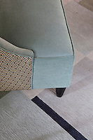 Detail of the finish on an armchair and woollen rug