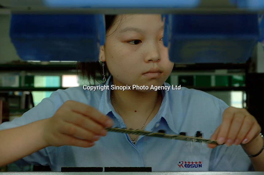 A worker at a production line at an electronics factory in Shenzhen, China, produces small circuit boards for use in various electronic items. Shenzhen Special Economic zone is one of the world's most intensive and dense manufacturing areas.  .