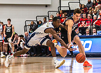 WASHINGTON, DC - JANUARY 29: Jameer Nelson Jr. #12 of George Washington and Luka Brajkovic #35 of Davidson go after a loose ball during a game between Davidson and George Wshington at Charles E Smith Center on January 29, 2020 in Washington, DC.