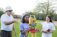 Hub King, a Mississippi State instructor of civil and environmental engineering, teaches Taneial Lindsay, a junior civil engineering major from Jackson, how to survey the Drill Field as Erin Fordice, a sophomore civil engineering major from Vicksburg, looks on.<br />  (photo by Megan Bean / &copy; Mississippi State University)