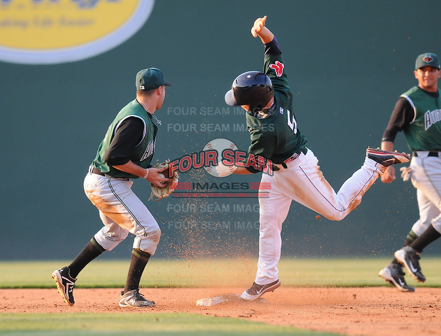 Infielder Sean Coyle (5) of the Greenville Drive steals second base with second baseman Raynor Campbell (31) of the Augusta GreenJackets defending  in a game against the  on April 10, 2011, at Fluor Field at the West End in Greenville, South Carolina. (Tom Priddy / Four Seam Images)