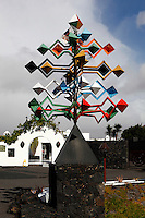 Low angle view of sculpture outside the Cesar Manrique Foundation, Taro de Tahiche, Lanzarote, Canary Islands, Spain, pictured on November 27, 2010 in the afternoon. Formerly the artist's studio and home, the house was built in 1968 on the site where a volcano erupted in 1730-36. The living space is formed from five volcanic bubbles and the style is inspired by the traditional local architecture. The Cesar Manrique Foundation, created in 1992, is devoted to the Arts, the Environment, and the conservation, study and promotion of the work of Cesar Manrique. Lanzarote, the Easternmost of the Canary Islands, lies 125km East of the African coast, in the Atlantic Ocean. Like the other islands in this autonomous Spanish archipelago, Lanzarote is originally Volcanic. Picture by Manuel Cohen.