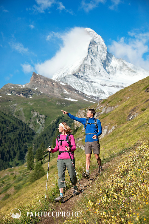 Couple hiking beneath the Matterhorn above Zermatt, Switzerland