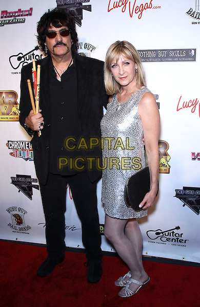 Carmine Appice & Leslie Gold.The second Annual Vegas Rocks! Magazine awards rocks the Las Vegas Hilton Hotel and Casino, Las Vegas, Nevada, USA..August 21st, 2011.full length black suit sunglasses shades moustache mustache facial hair drumsticks silver dress couple .CAP/ADM/MJT.© MJT/AdMedia/Capital Pictures.