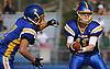 Matthew Sluka #10, Kellenberg quarterback, right, hands off to Jordan DeLucia #7, who rushes for a touchdown during the second quarter of a CHSAA varsity football game against Holy Trinity at Mitchel Athletic Complex in Uniondale on Sunday, Sept. 17, 2017. Kellenberg won by a score of 45-0.