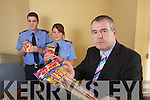 Gardai Pat Naughton and Marie McCarthy on Left and Inspector Dan Keane on Right with some confiscated Frieworks at Tralee Garda Station.