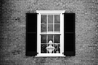 A Jefferson statue rests on a window sill at the University of Virginia in Charlottesville, Va. Photo/Andrew Shurtleff Photography, LLC