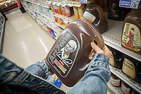 "A thirsty shopper chooses a gallon jug of Arizona's Arnold Palmer Half & Half, iced tea and lemonade, in a supermarket in New York on Monday, September 26, 2016. The popular ""King of Golf"" passed away Sunday of complications from heart problems at the age of 87. Palmer was in the vanguard of sports marketing and was one of the highest earners in the golf world. (© Richard B. Levine)"