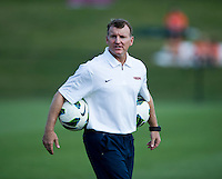 Virginia head coach Steve Swanson watches his team before the game at Klockner Stadium in Charlottesville, VA.  Virginia defeated Duke, 1-0.